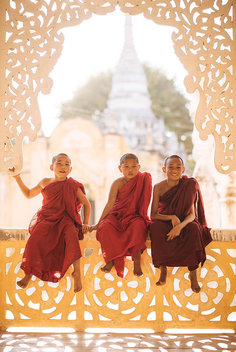 buddhist-monks-sitting-bagan-myanmar-asia