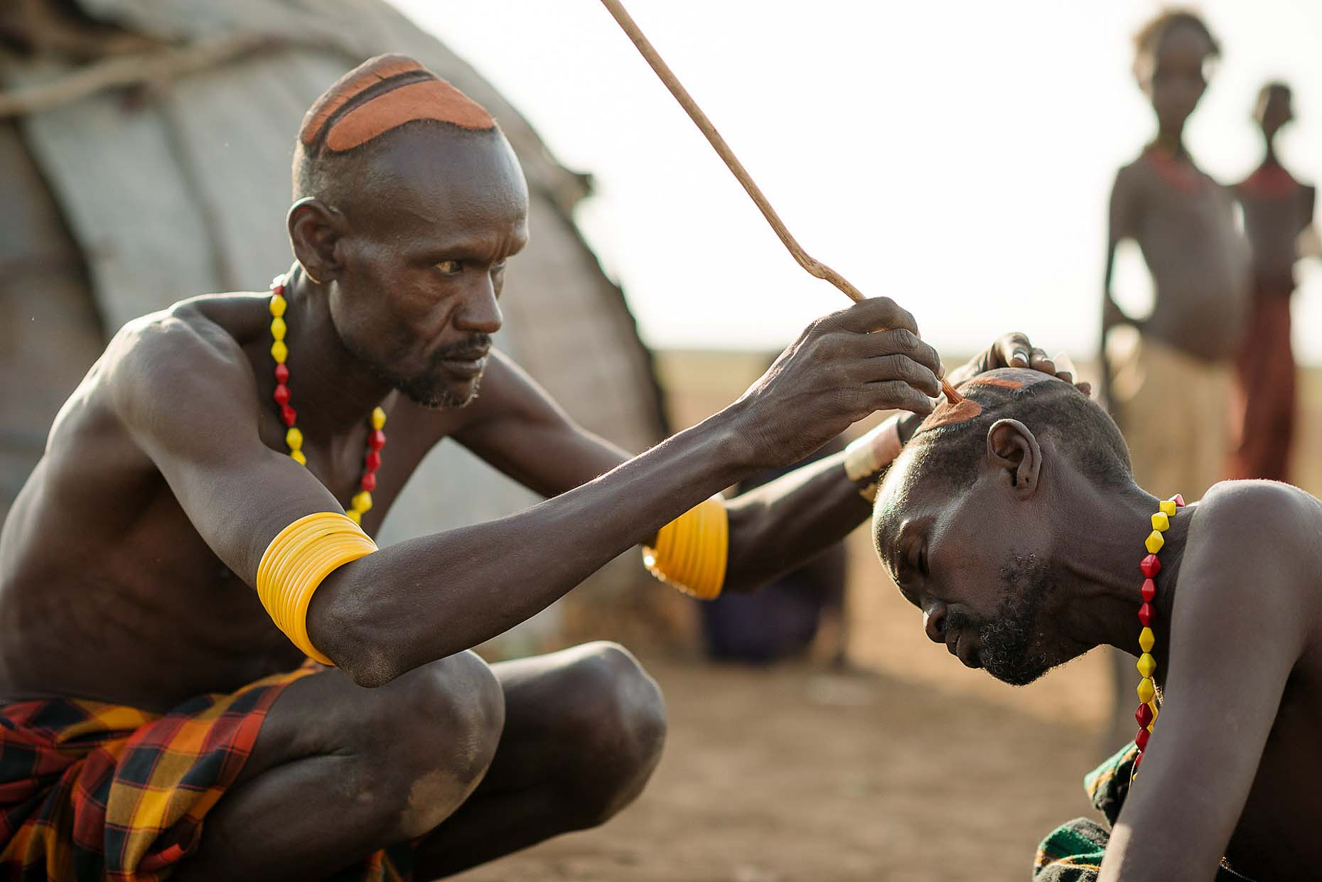 men-applying-clay-hair-decoration-traditional-dassenech-tribe-omorate-omo-valley-ethiopia-africa-15