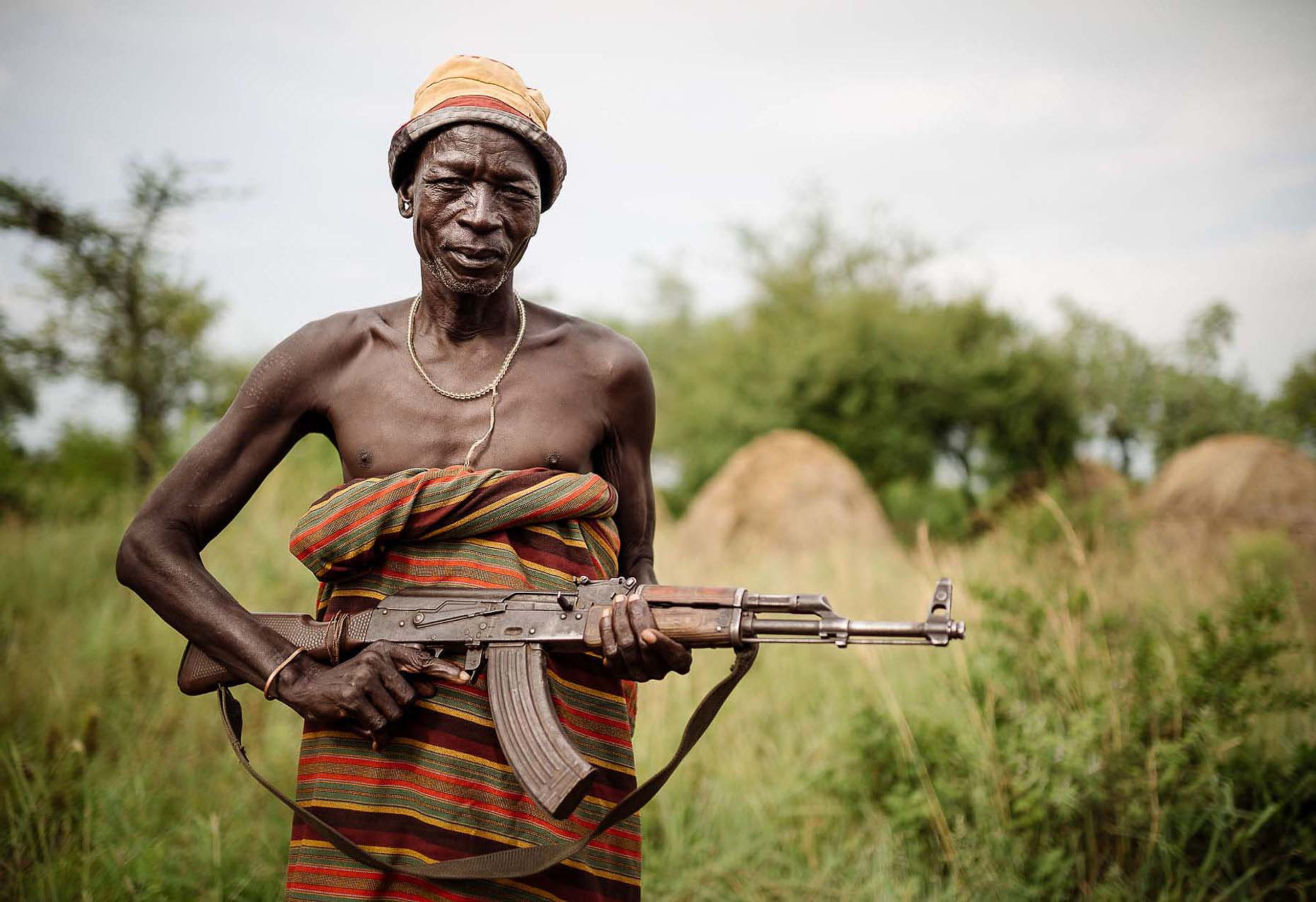 olehein-rifle-gun-armed-man-mursi-tribe-omo-valley-29