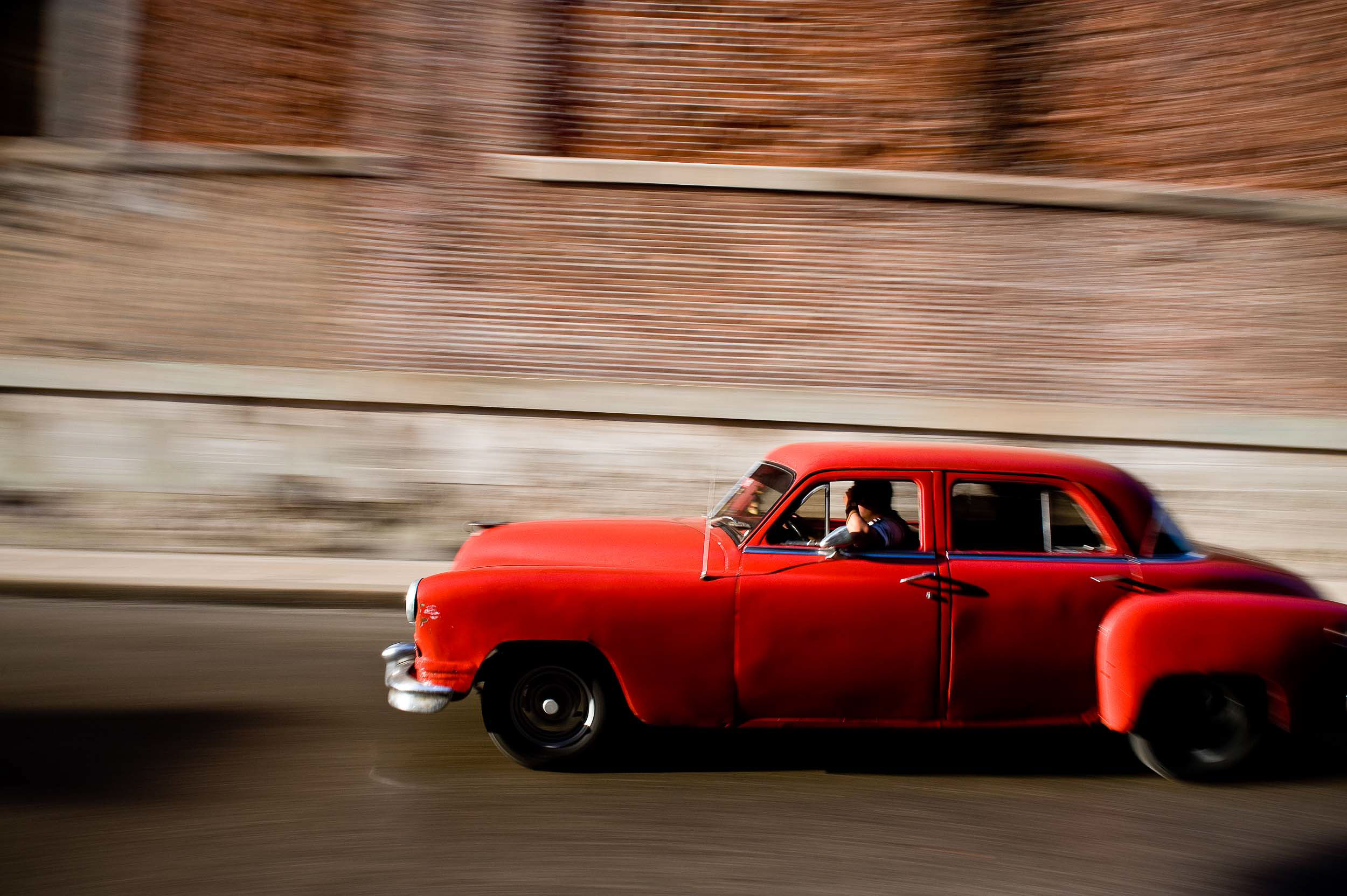 red-car-cuban-motion-travel-photographer-transport-havana-cuba