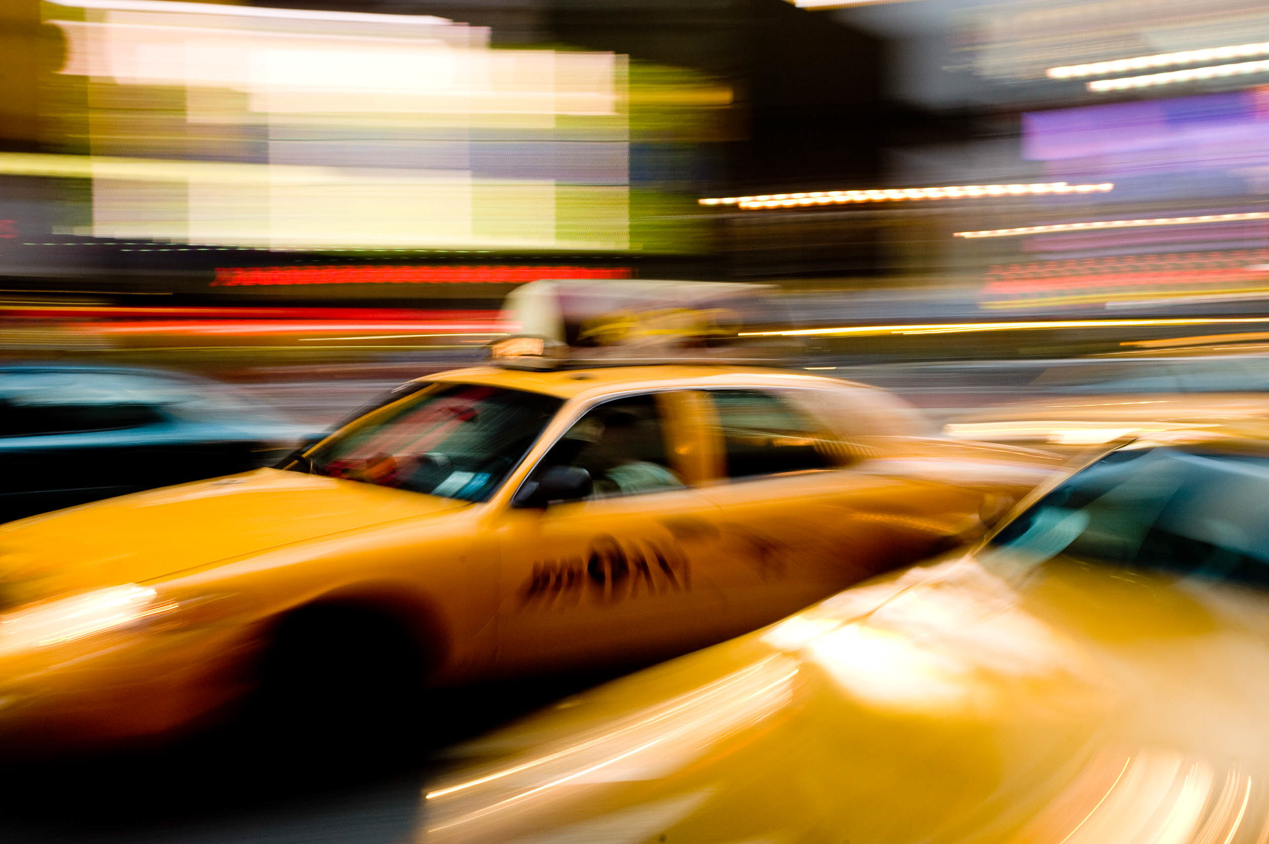 yellow-taxi-cab-car-blur-motion-movement-rush-times-square-travel-manhattan-new-york-city-usa-america